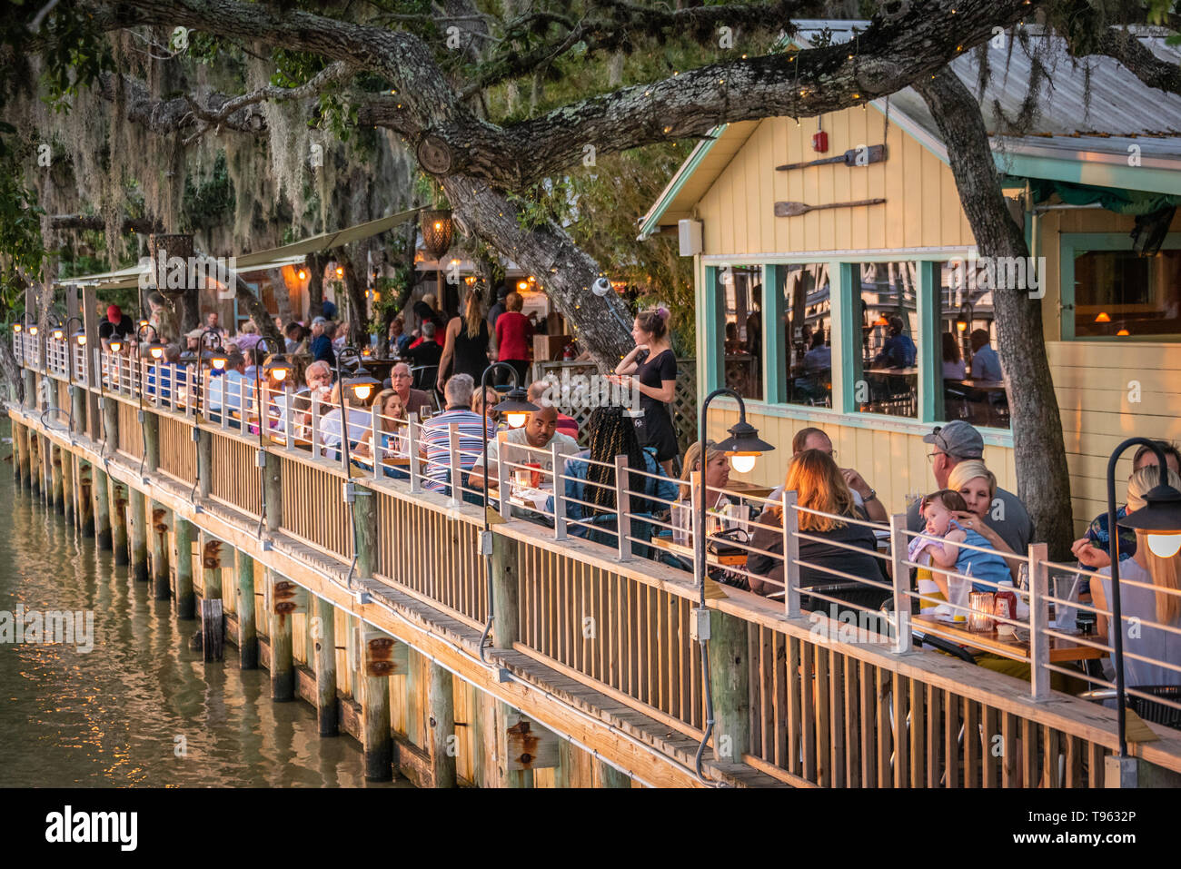 Waterfront sunset dining on the Intracoastal Waterway at Caps on the Water in St. Augustine, Florida. (USA) - Stock Image