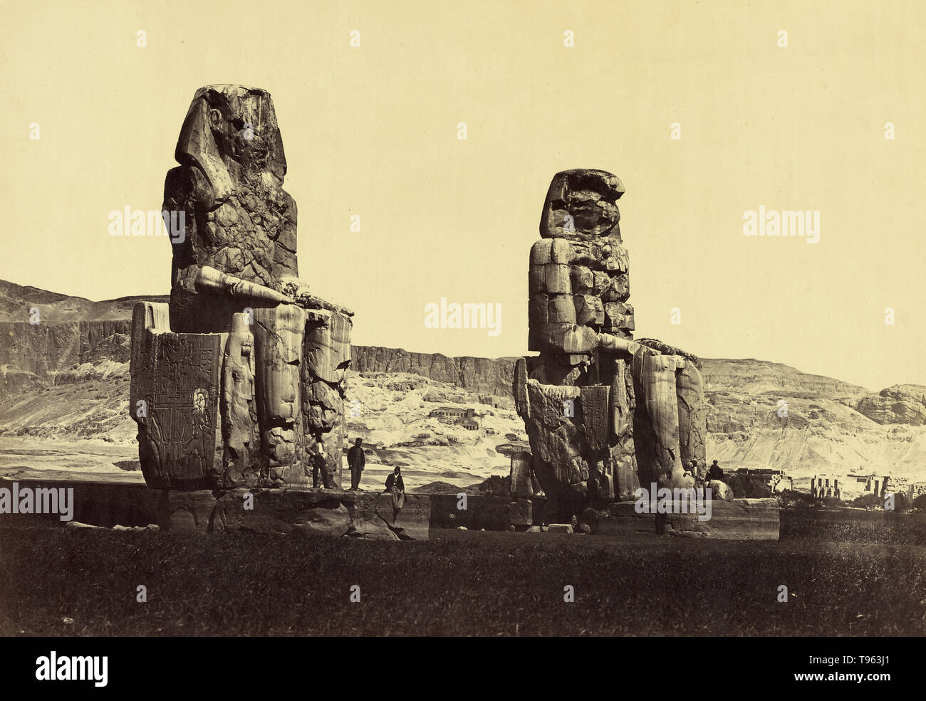 Colossi of Memnon, Thebes, Egypt, c. 1880s. Antonio Beato (English, born Italy, about 1835 - 1906). Albumen silver print. The Colossi of Memnon (Arabic: el-Colossat?? or es-Salamat) are two massive stone statues of the Pharaoh Amenhotep III, who reigned in Egypt during the Dynasty XVIII. For the past 3,400 years (since 1350 BC), they have stood in the Theban Necropolis, located west of the River Nile from the modern city of Luxor. Stock Photo