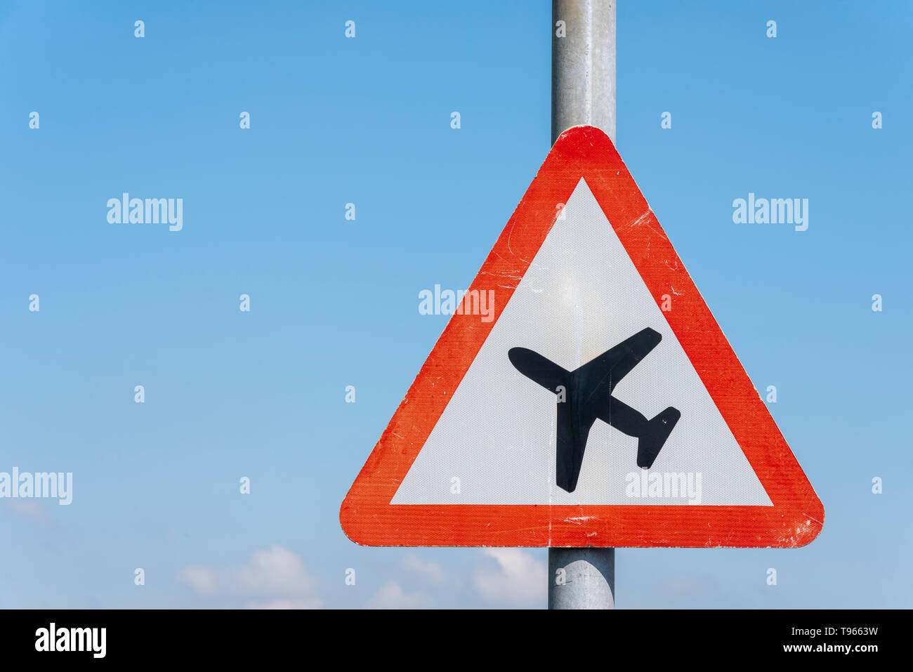 Warning sign. Highway code Low-flying aircraft or sudden aircraft noise red triangle warning sign near London Southend Airport, Essex, UK. Space - Stock Image
