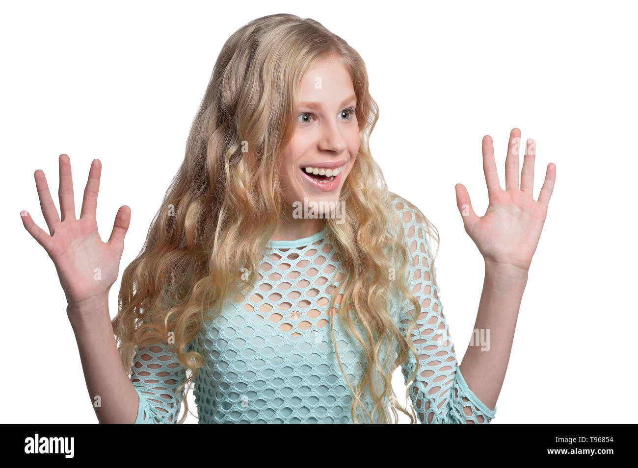 Portrait of cute blonde teen girl on white background Stock Photo