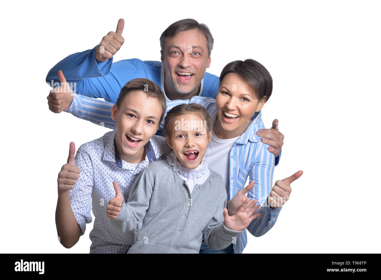 Happy smiling family posing together on white background - Stock Image