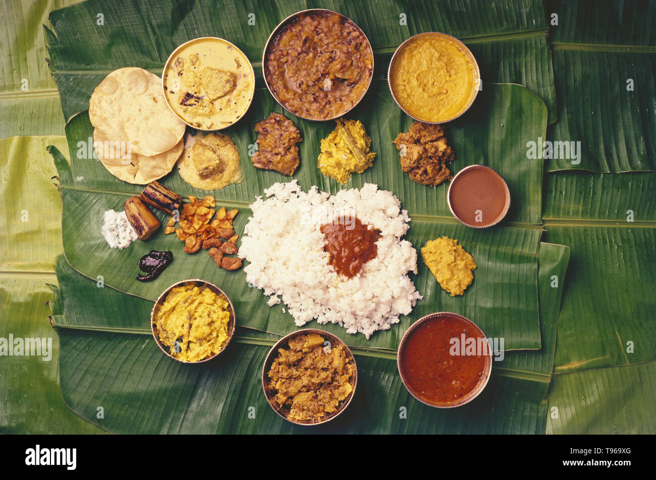 Kerala tradional meal served on a banyan leaf - Stock Image