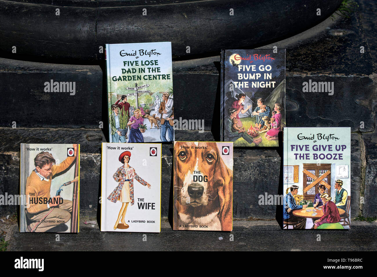 Spoof Ladybird and Famous Five books for sale at a charity book sale in Edinburgh, Scotland, UK. - Stock Image