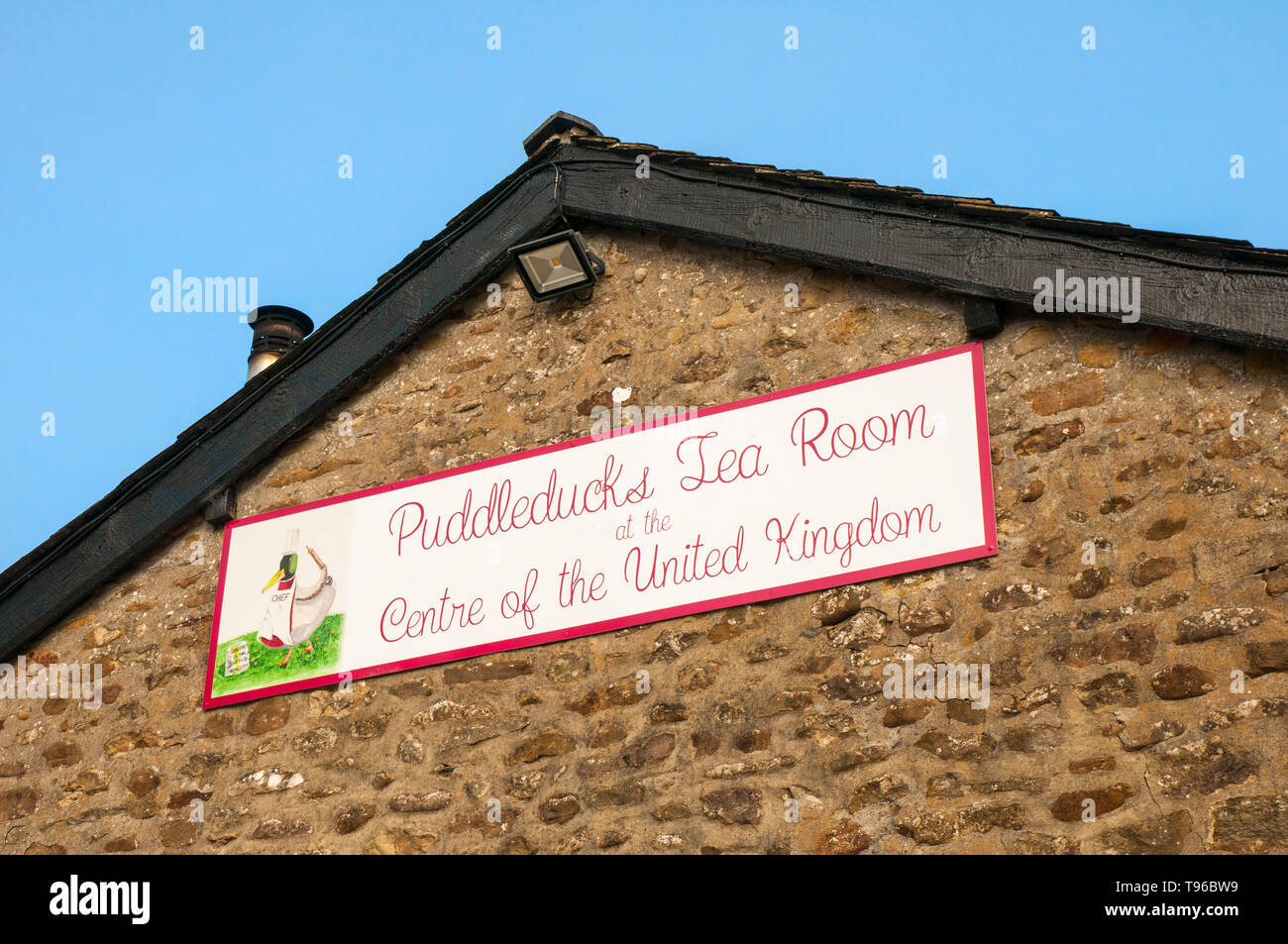 Sign on side of Post Office building at Dunsop Bridge Forest of Bowland Lancashire England UK.Puddleducks Tea Room at the Centre of the United Kingdom Stock Photo