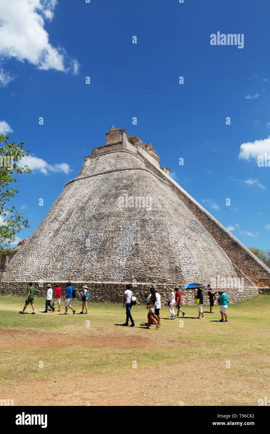 Latin America tourism - tourists at the Pyramid of the Magician, Maya ruins at Uxmal UNESCO world heritage site, Uxmal, Yucatan Mexico Latin America - Stock Image