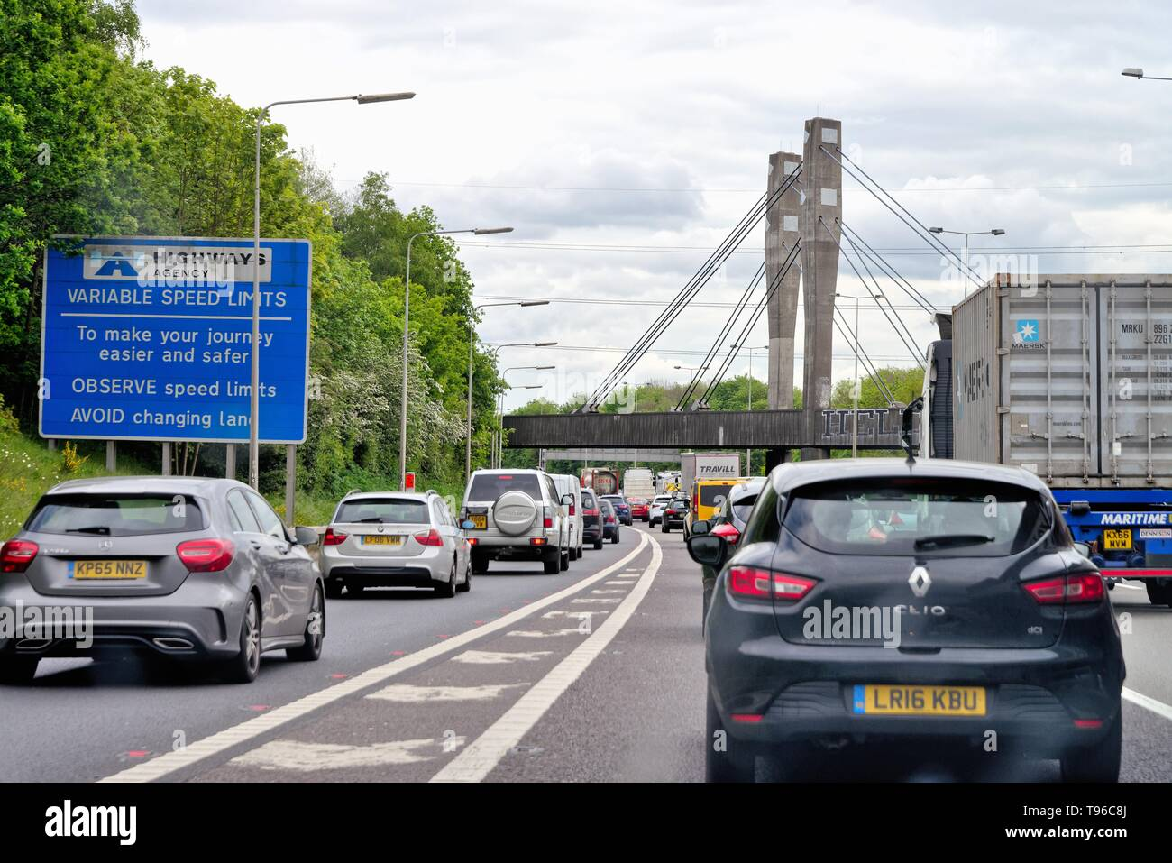 A drivers point of view of heavy congestion on the M25 motorway at the M3 junction Chertsey Surrey England UK - Stock Image