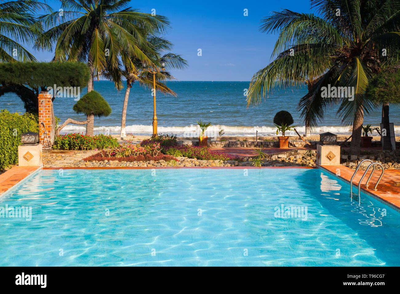 Swimmimgpool at TTC Resort, South China Sea,Phan Rang, Ninh Thuan,Vietnam, Asia - Stock Image