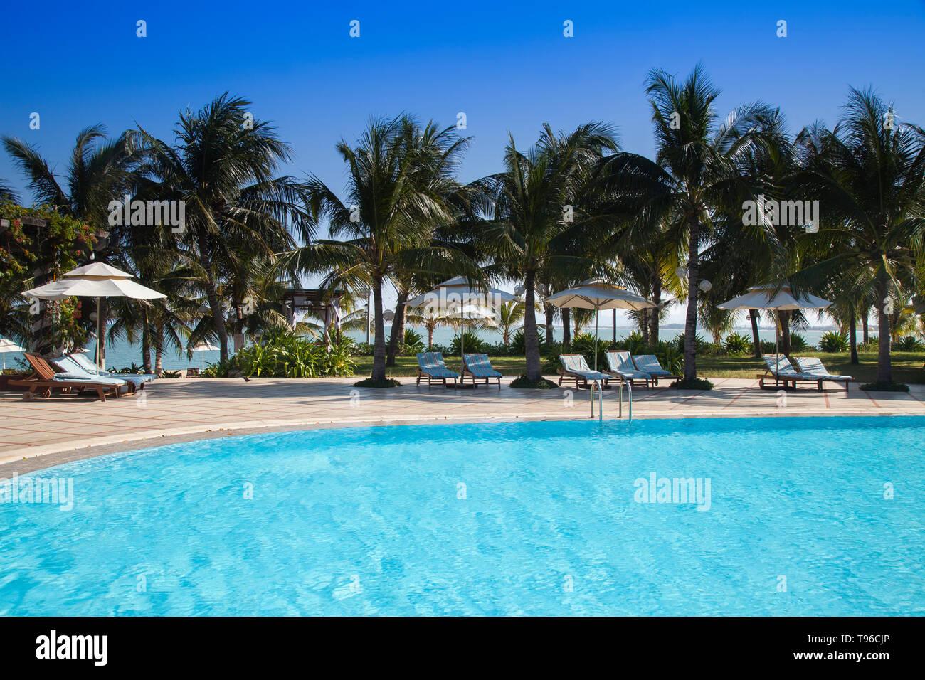 Swimming pool of Saigon Ninh Chu Resort on Phan Rang Beach,south china sea, Ninh Thuan, Vietnam - Stock Image