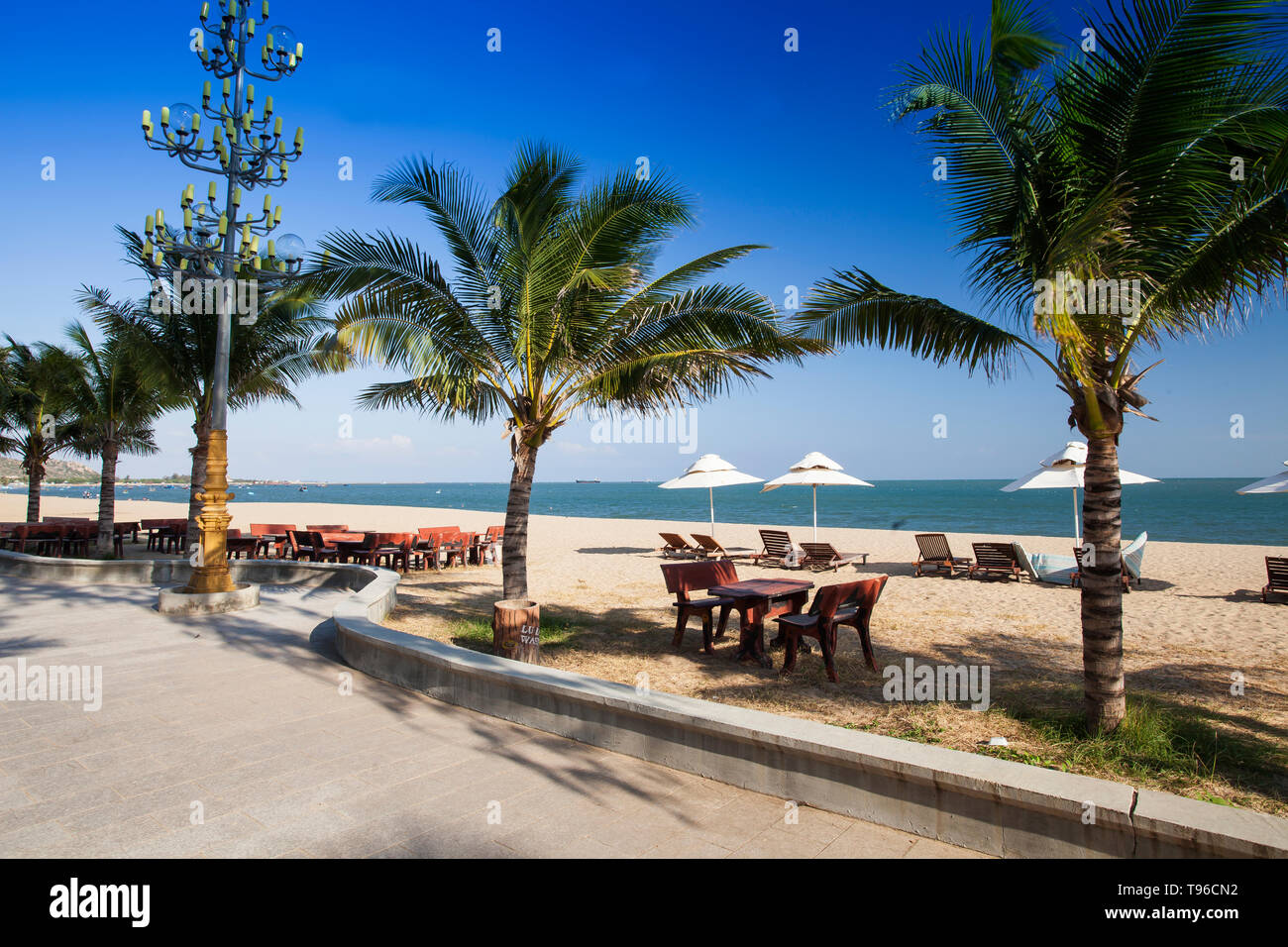 Beach promenade near Saigon Ninh Chu Resort on Phan Rang Beach,south china sea, Ninh Thuan, Vietnam - Stock Image