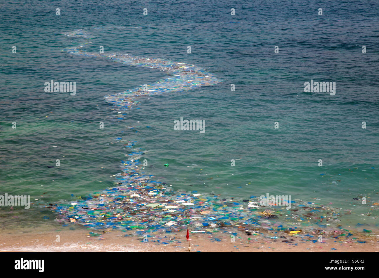 Plastic waste is stranded on the beach at Cam Ranh, south china sea, Ninh Thuan, Vietnam - Stock Image
