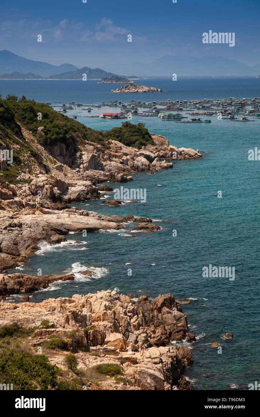 Rocky coast landscape near the floating market Binh Hung at Vinh Hy, South China Sea,Ninh Thuan, Vietnam - Stock Image