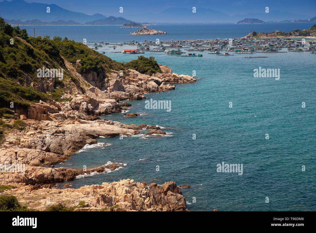 Rocky coast landscape near the floating market Binh Hung at Vinh Hy, South China Sea,Ninh Thuan, Vietnam Stock Photo