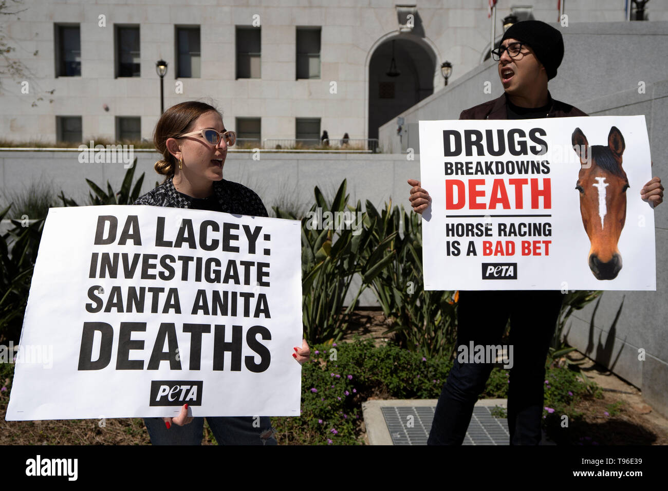 Demonstrators are seen holding placards during the protest. Animal right activists held a PETA protest against the death of 22 horses at the Santa Anita Racetrack. The protesters holding placards also called on the Los Angeles District Attorney to open a criminal investigation and suspend racing while investigating the cause of the death. - Stock Image
