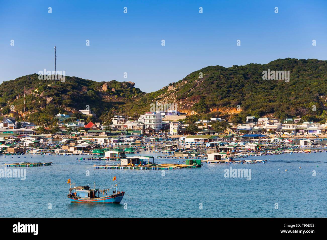 Rocky coast landscape look at island Binh Houng at Vinh Hy, South China Sea,Ninh Thuan, Vietnam - Stock Image