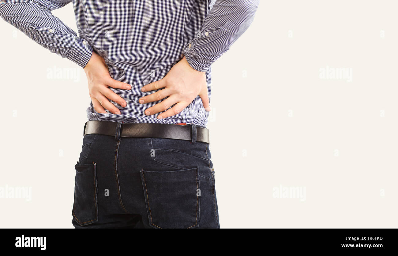 Knee pain. The man is holding his sore knee. Knee injury. - Stock Image
