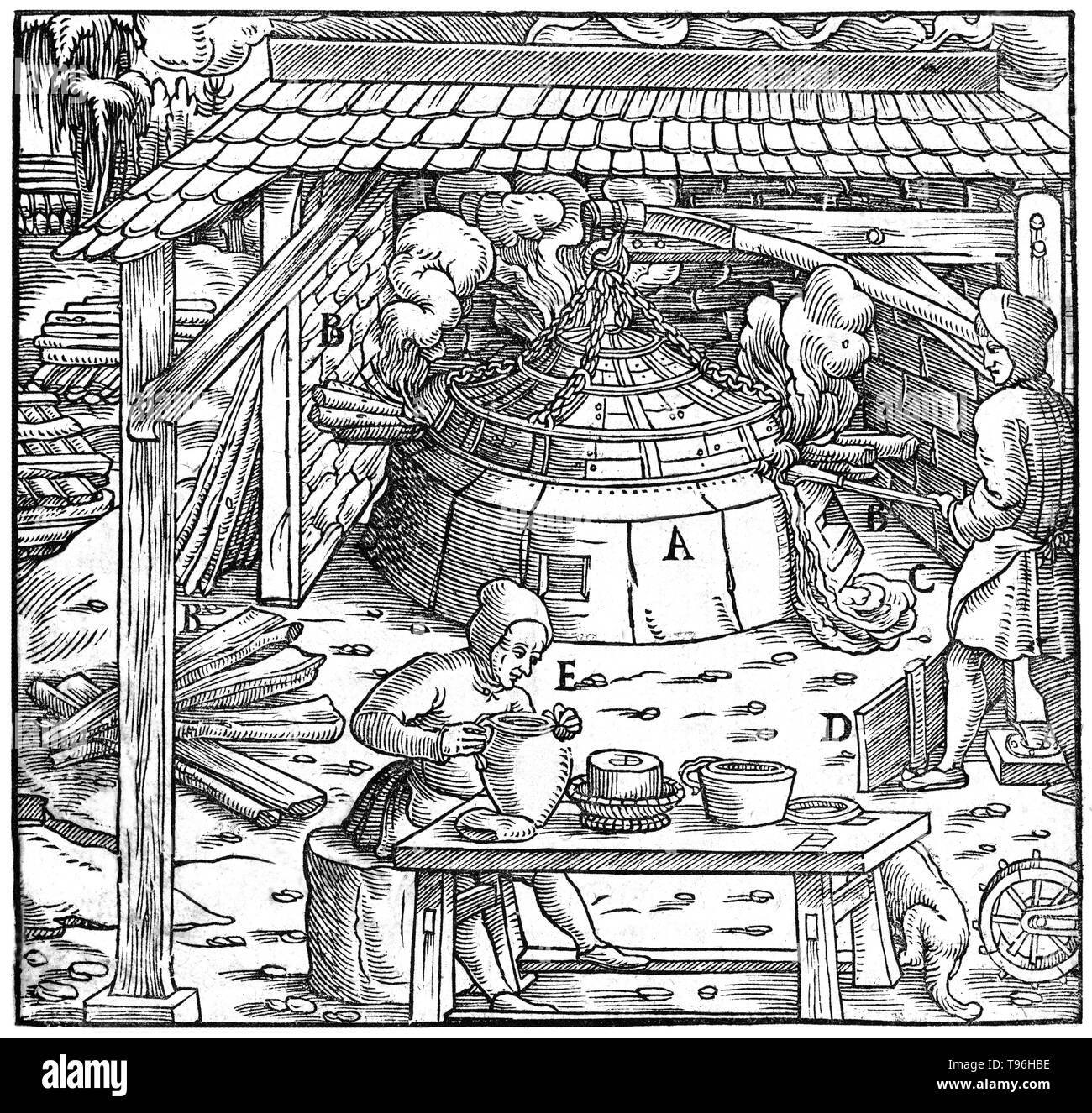 Woodcut from De Re Metallica. Alchemists or metallurgists separating lead from silver or gold in a cupellation furnace. Georgius Agricola (March 24, 1494 - November 21, 1555) was a German scholar known as 'the father of mineralogy'. His book De Re Metallica, published in 1556, was a treatise on mining and extractive metallurgy, illustrated with woodcuts illustrating processes to extract ores from the ground and metal from the ore, and the many uses of water mills in mining. Agricola described and illustrated how ore veins occur in and on the ground, making the work an early contribution to the - Stock Image