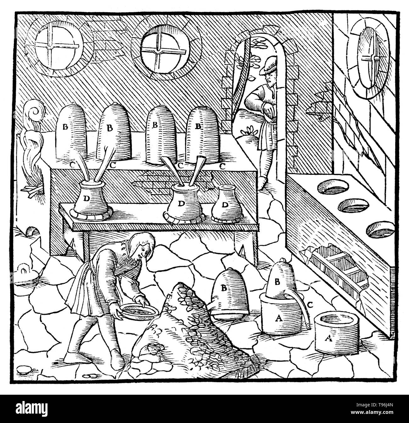 Woodcut from De Re Metallica. The distillation of quicksilver (refining). Georgius Agricola (March 24, 1494 - November 21, 1555) was a German scholar and scientist, known as ''the father of mineralogy''. In 1556 he published his book De Re Metallica, a treatise on mining and extractive metallurgy, with woodcuts illustrating processes to extract ores from the ground and metal from the ore, and the many uses of water mills in mining. He described and illustrated how ore veins occur in and on the ground, making the work an early contribution to the developing science of geology. He described pros - Stock Image