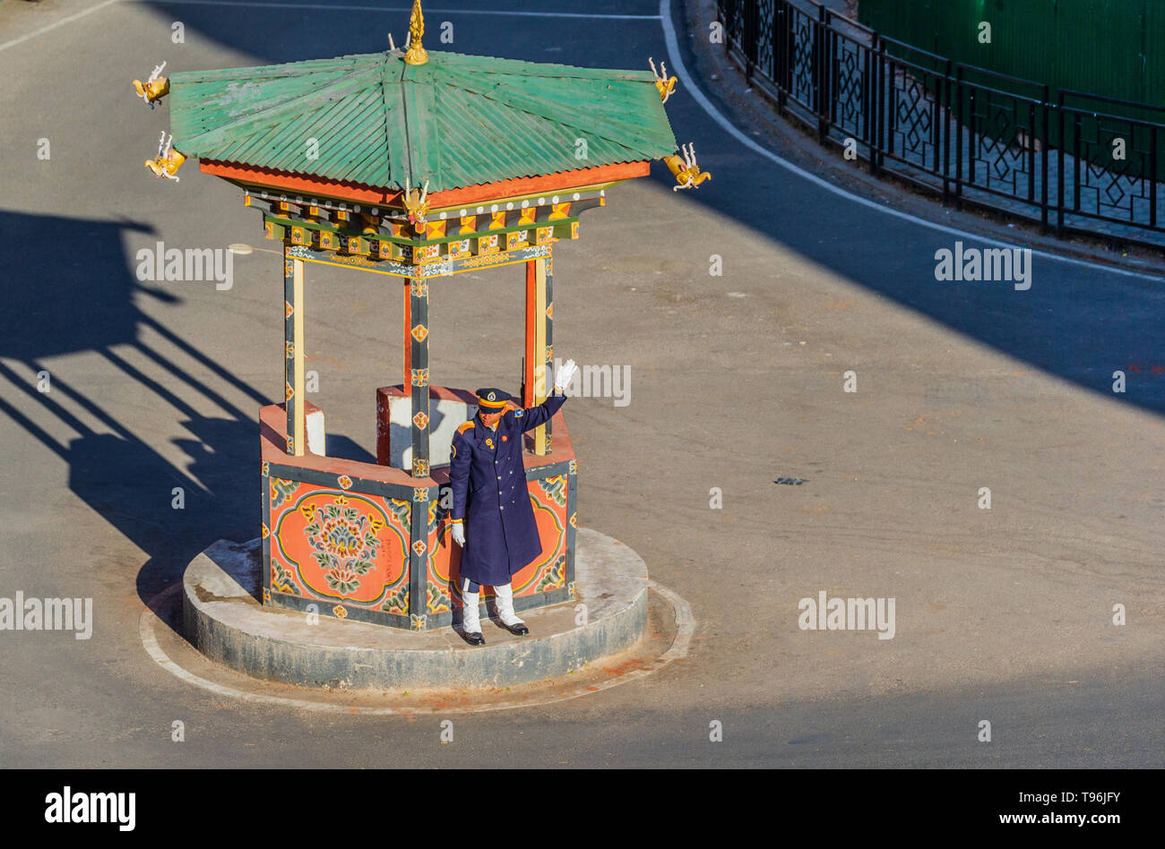 Policeman directing traffic in the capital of Bhutan Thimpu. Bhutan doesn't have any traffic lights. - Stock Image
