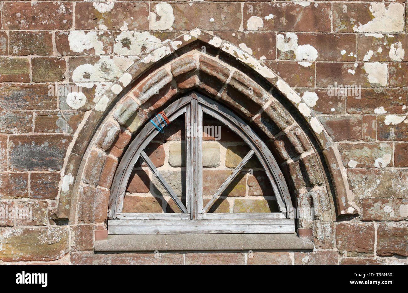 Close-up of a window surround, part of the Chapter House at Cockersand Abbey, Lancashire, a Grade 1 listed building and Scheduled Ancient Monument. - Stock Image