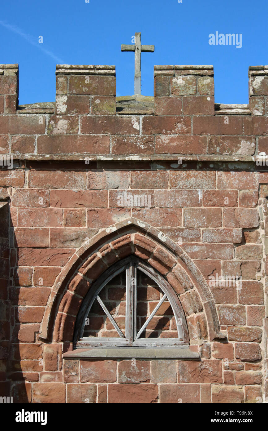 Close-up window and wooden cross, part of the Chapter House at Cockersand Abbey, Lancashire, a Grade 1 listed building and Scheduled Ancient Monument. - Stock Image