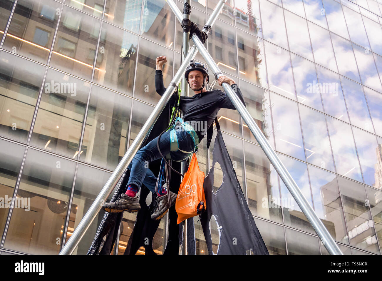 New York, United States. 16th May, 2019. Protests against Chase Bank for its role as the world's worst funder of climate change escalated as climate activists erected and scaled a two-story, steel tripod structure, blocking 47th St at Madison Ave, in front of Chase's new flagship global corporate headquarters. One arrest was while a group of supporting demonstrators chanted and displayed banners calling on Chase to end its massive funding of fossil fuels. Credit: Erik McGregor/Pacific Press/Alamy Live News - Stock Image