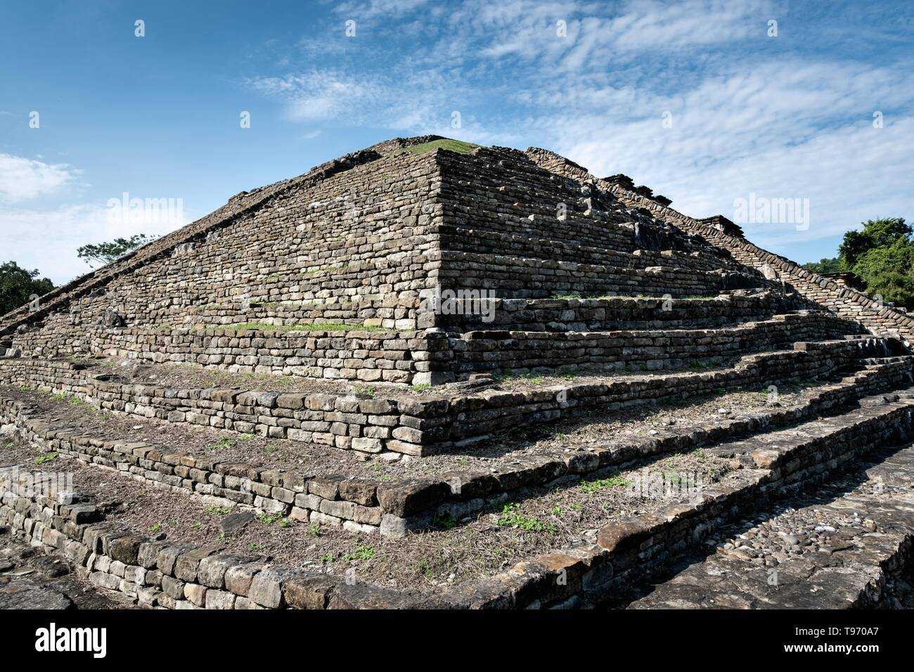 Mesoamerica pyramid called building 19 in the Arroyo Group at the pre-Columbian archeological site of El Tajin in Tajin, Veracruz, Mexico. El Tajín flourished from 600 to 1200 CE and during this time numerous temples, palaces, ballcourts, and pyramids were built by the Totonac people and is one of the largest and most important cities of the Classic era of Mesoamerica. - Stock Image