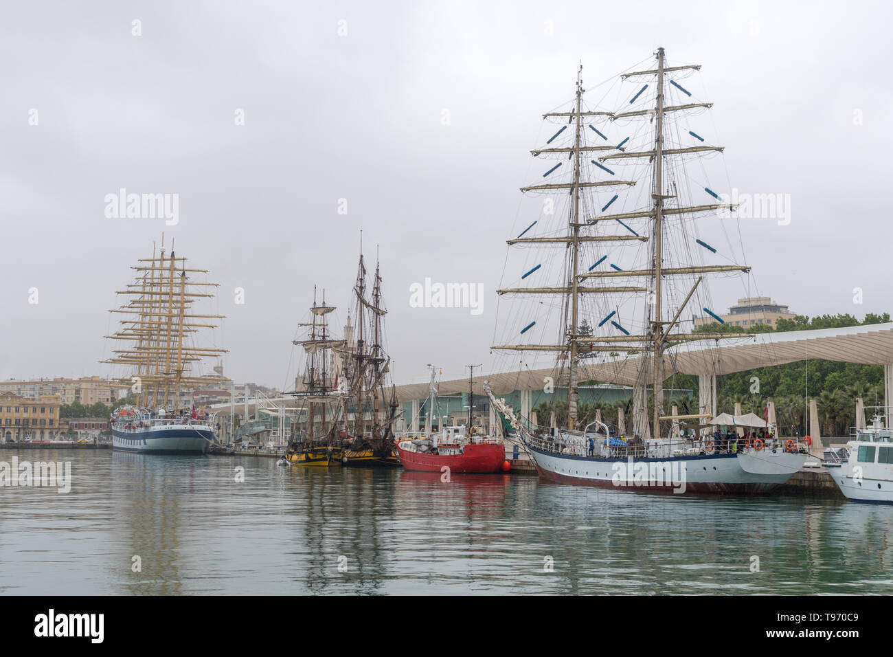 Multi-mast sailing ships at the pier in the port - Stock Image