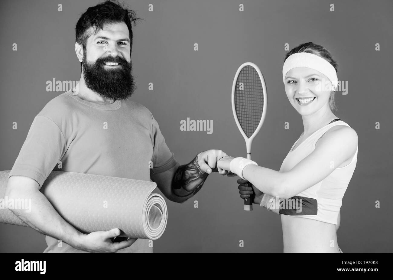 Sport coach. Athletic Success. Sporty couple training with coach. Strong muscles and body. Sport equipment. Happy woman and bearded man workout in gym. best coach ever. good coach brings great result. - Stock Image