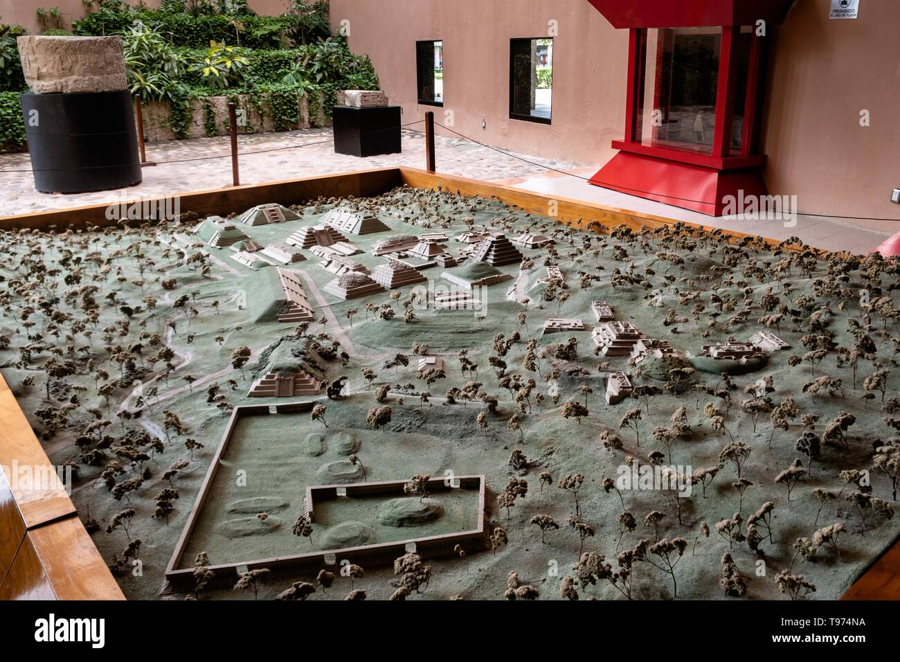 An architectural model in miniature of the pre-Columbian archeological complex of El Tajin on display in the museum in Tajin, Veracruz, Mexico. El Tajín flourished from 600 to 1200 CE and during this time numerous temples, palaces, ballcourts, and pyramids were built by the Totonac people and is one of the largest and most important cities of the Classic era of Mesoamerica. - Stock Image
