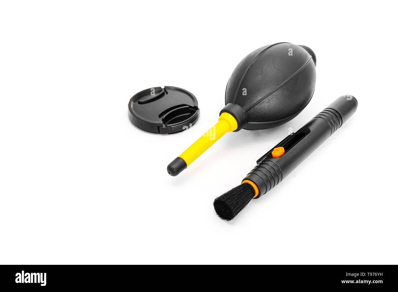 Closeup Lens Pen, Blower Brush and Lens Cover Black Color Tool (Symbol) for Clean Photographic Equipment. Camera Cleaning Set Isolated on White Studio Stock Photo