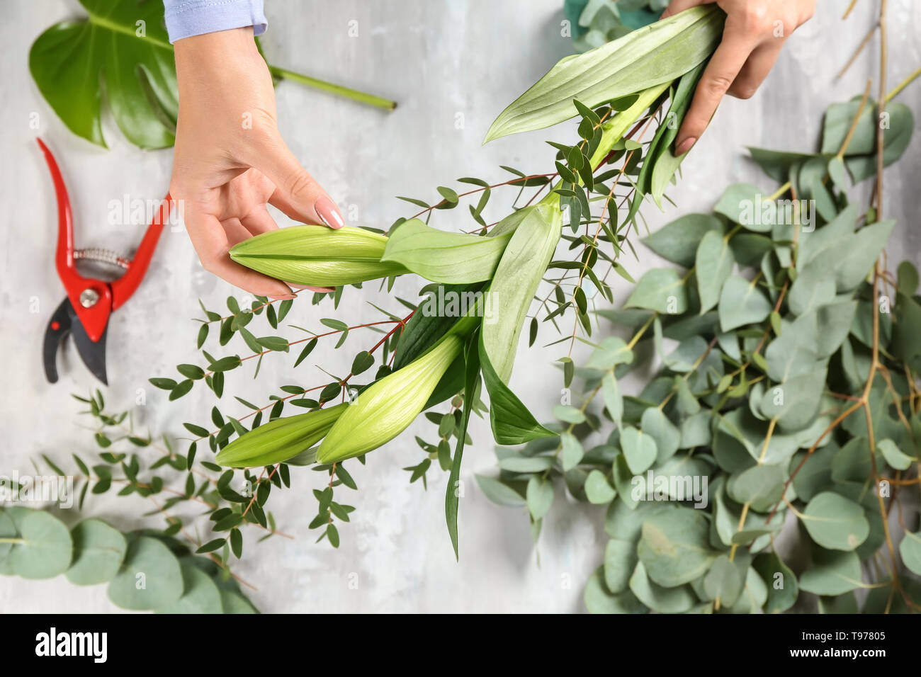 Florist making beautiful bouquet, closeup - Stock Image