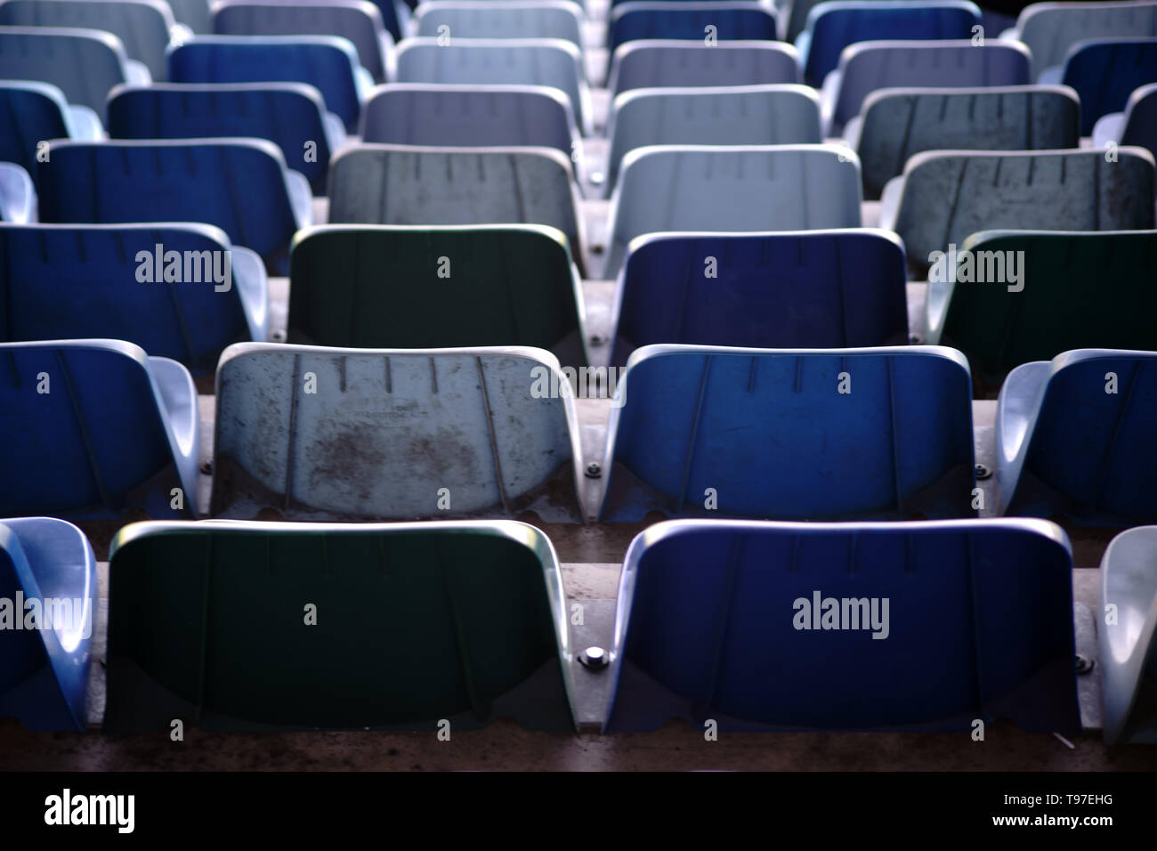 The rear view on the backs and seats of rows of seats in a stadium. - Stock Image