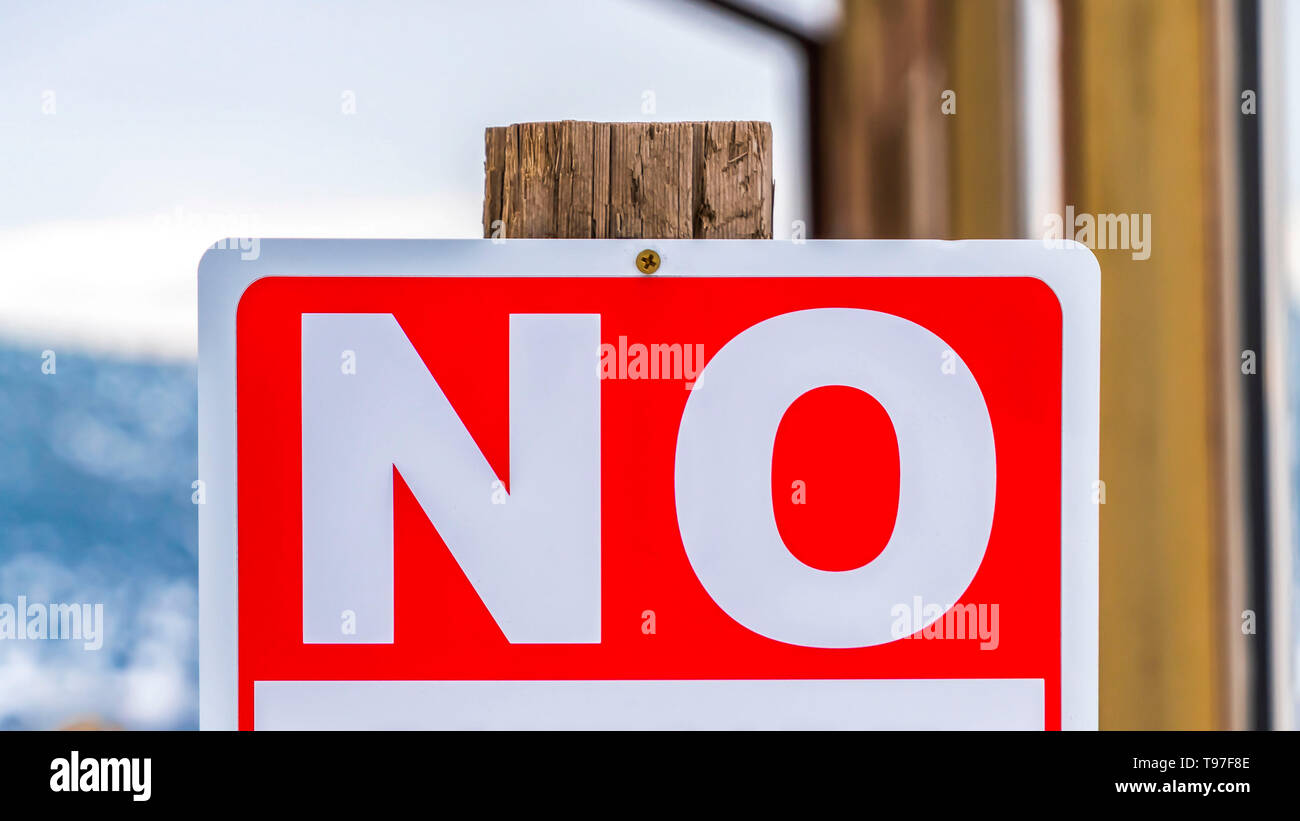 Clear Panorama Close up view of a sign post that reads No Outside Alcohol Permitted - Stock Image