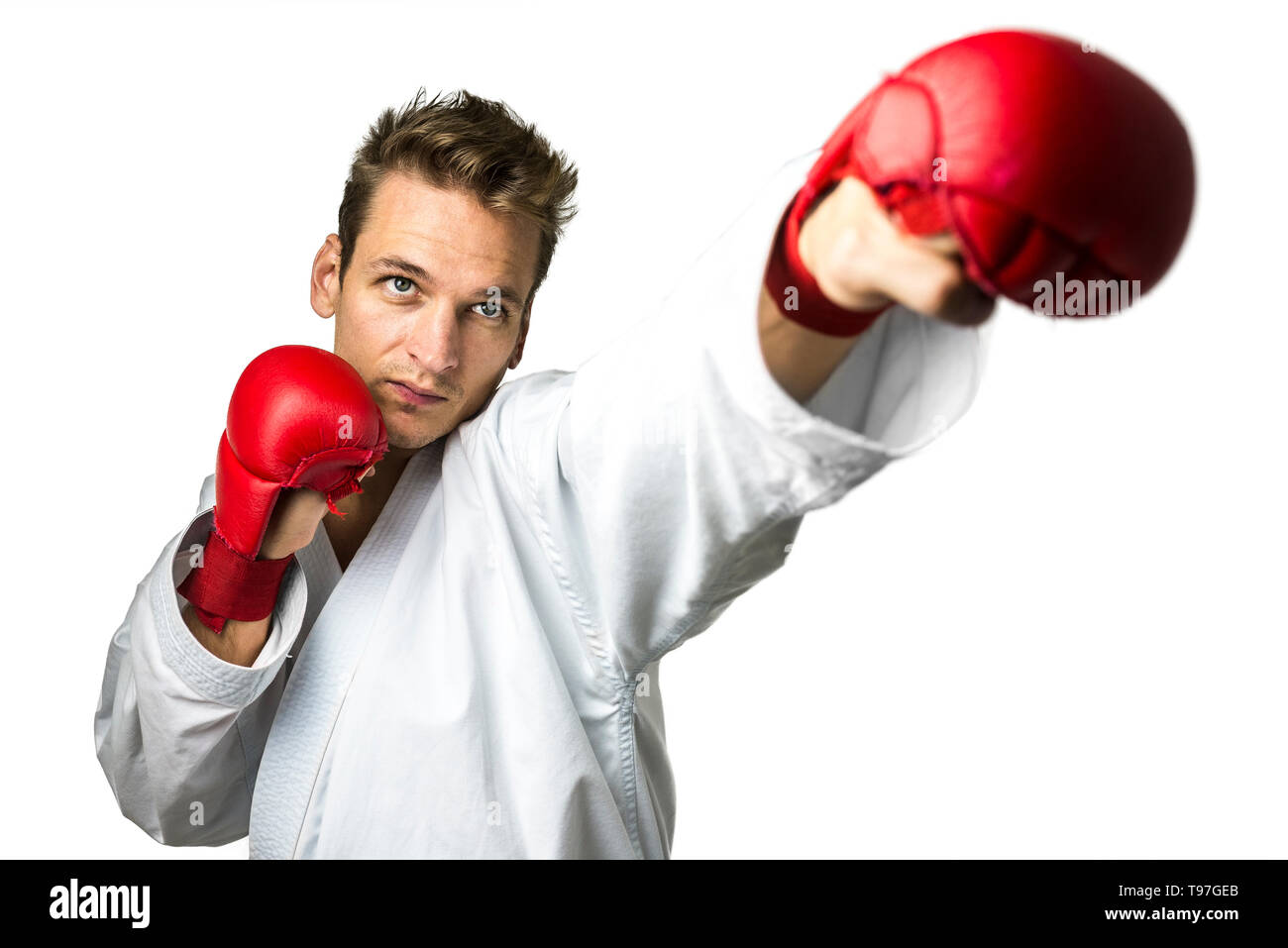 Professional kickboxer isolated over white background. - Stock Image