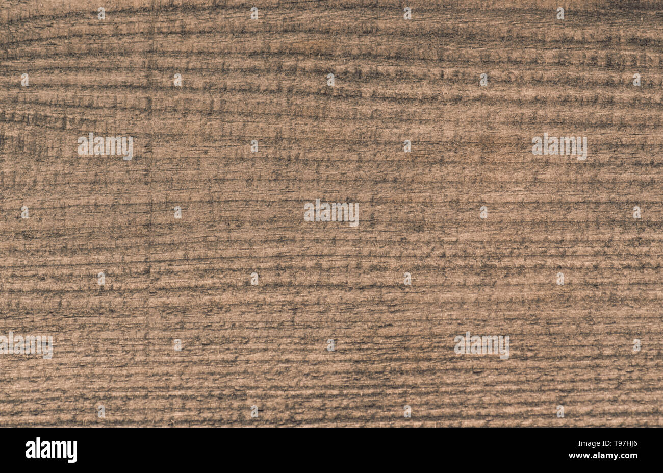 background texture of old wooden plank with stripes and scratches - Stock Image