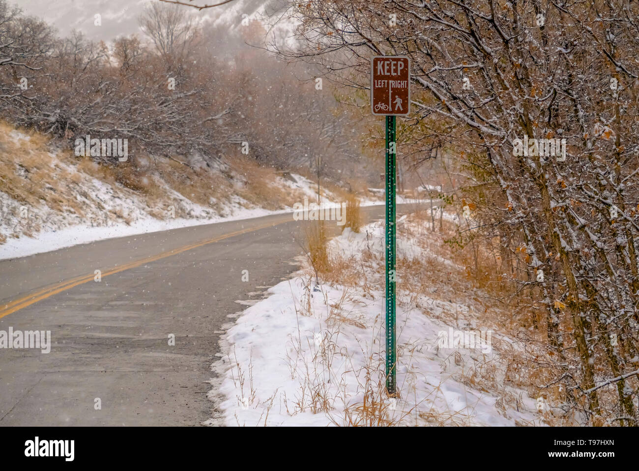 Winter road with traffic sign in Salt Lake City Stock Photo