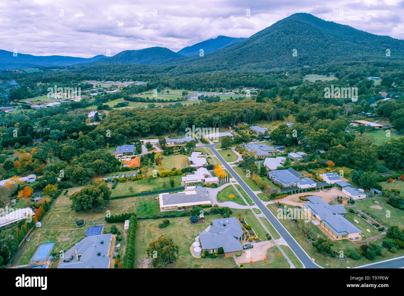 Aerial view of scenic rural living quarters among forest and mountains. Healesville, Australia - Stock Image