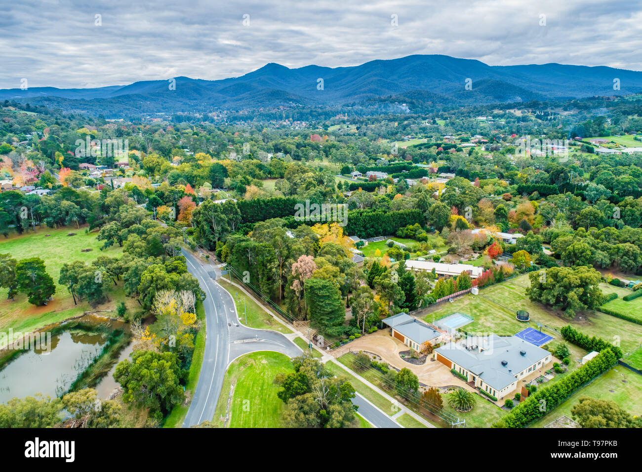Aerial landscape of rural houses among trees in fall. Healesville, Victoria, Australia - Stock Image