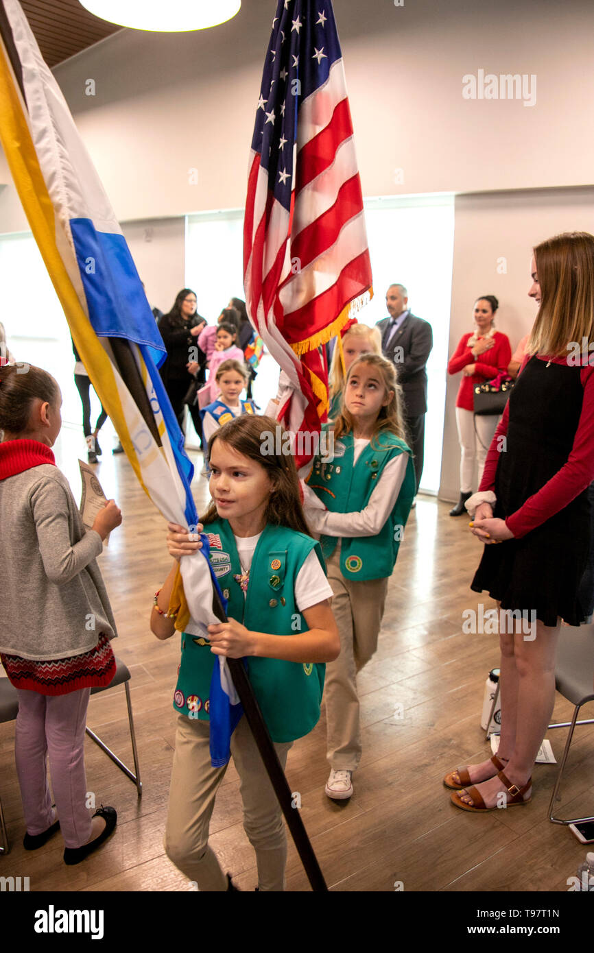 A Girl Scout color guard in Newport Beach, CA, marches at a government ceremony. - Stock Image