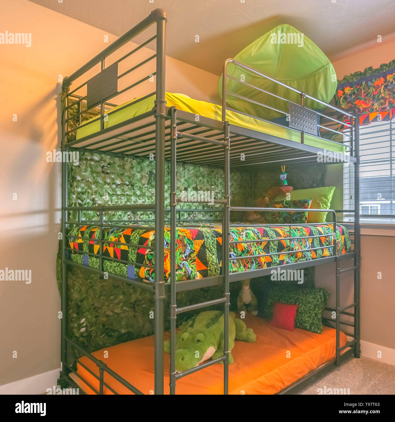 Square Cozy Room Interior With A Colorful Triple Bunk Bed For Children Stock Photo Alamy