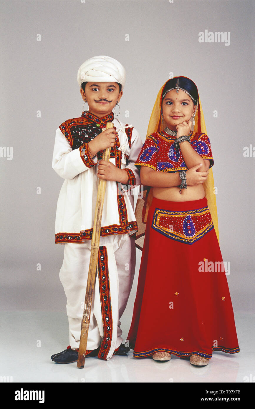 30daef59e PORTRAIT OF A COUPLE FROM GUJARAT IN TRADITIONAL COSTUME. THESE ARE  CHILDREN AGED 12,