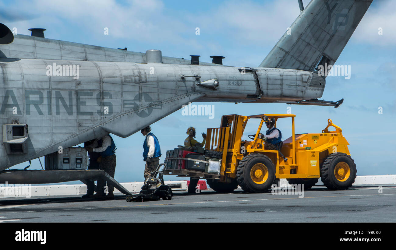 190501-M-QS181-0025 PACIFIC OCEAN (May 1, 2019) U.S. Marines aboard the San Antonio-class amphibious transport dock ship USS John P. Murtha (LPD 26) unload a CH-53E Super Stallion on the flight deck. The Super Stallions transported Aviation Combat Element equipment aboard the USS John P. Murtha during routine operations as part of the Boxer Amphibious Ready Group. (U.S. Marine Corps photo by Cpl. Jason Monty) - Stock Image