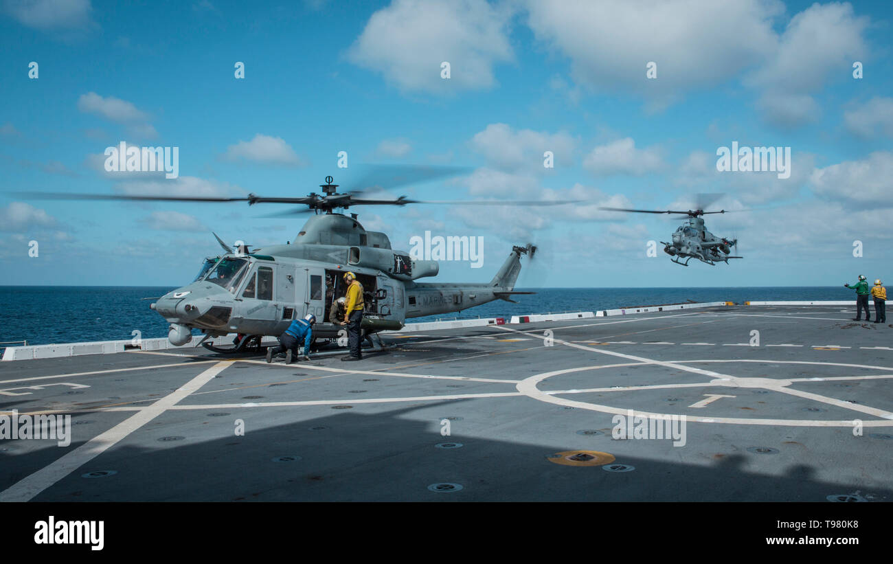 190501-M-QS181-0113 PACIFIC OCEAN (May 1, 2019) U.S. Marines with Marine Medium Tiltrotor Squadron (VMM) 163 (Reinforced), 11th Marine Expeditionary Unit (MEU), land aircraft on the flight deck of the San Antonio-class amphibious transport dock ship USS John P. Murtha (LPD 26). The Marines and Sailors embarked aircraft and personnel aboard the USS John P. Murtha during routine operations as part of the Boxer Amphibious Ready Group. (U.S. Marine Corps photo by Cpl. Jason Monty) - Stock Image