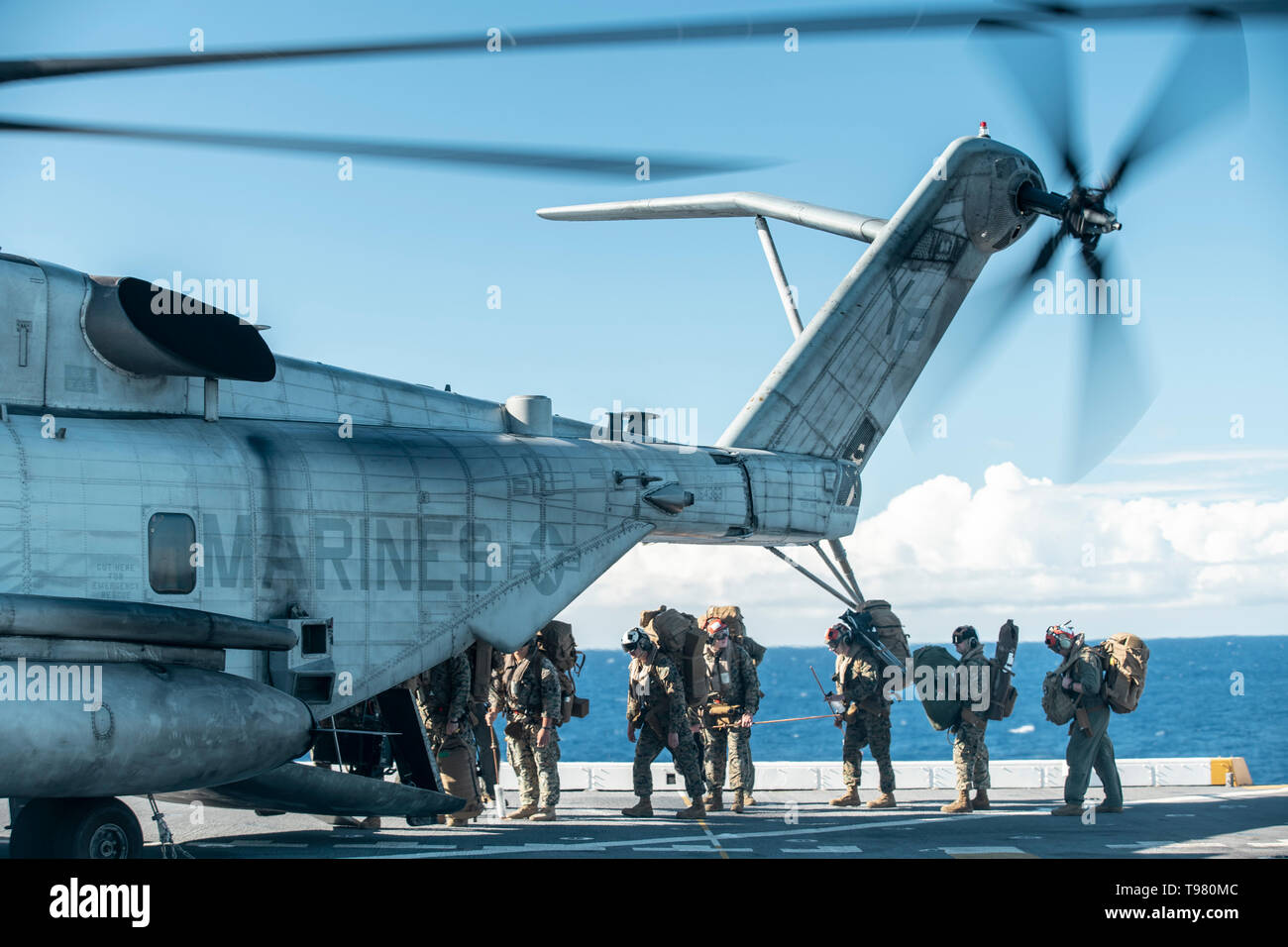 190511-M-HB658-0042 PACIFIC OCEAN (May 11, 2019) U.S. Marines with Marine Medium Tiltrotor Squadron (VMM) 163 (Reinforced), 11th Marine Expeditionary Unit (MEU), load into a CH-53E aboard the San Antonio-class amphibious transport dock ship USS John P. Murtha (LPD 26). The Marines and Sailors of the 11th MEU are conducting routine operations as part of the Boxer Amphibious Ready Group. (U.S. Marine Corps photo by Staff Sgt. Donald Holbert) - Stock Image