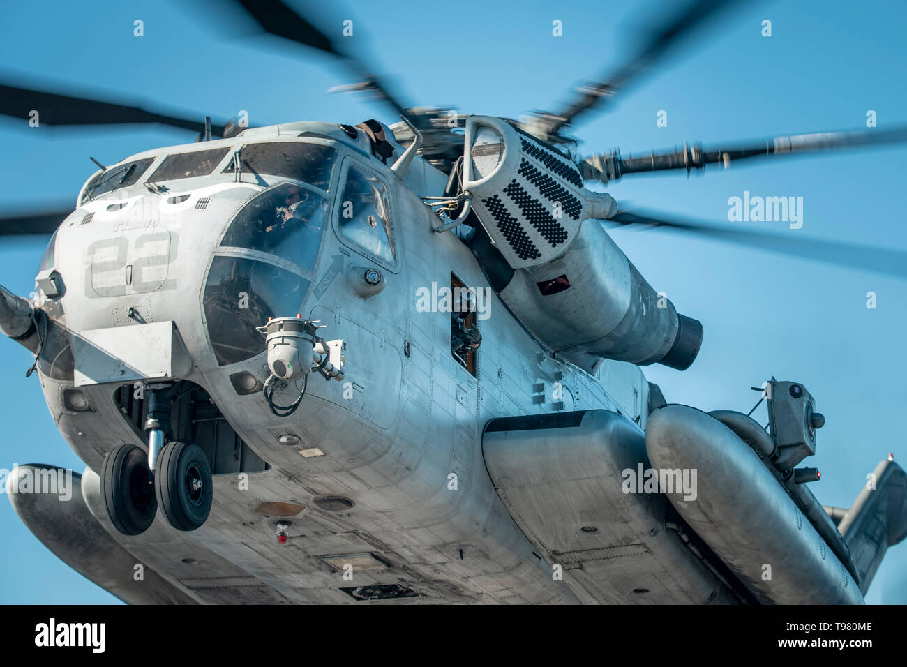 190511-M-HB658-0061 PACIFIC OCEAN (May 11, 2019) A U.S. Marine Corps CH-53E with Marine Medium Tiltrotor Squadron (VMM) 163 (Reinforced), 11th Marine Expeditionary Unit (MEU), takes off during flight operations. The Marines and Sailors of the 11th MEU are conducting routine operations as part of the Boxer Amphibious Ready Group. (U.S. Marine Corps photos by Staff Sgt. Donald Holbert) - Stock Image