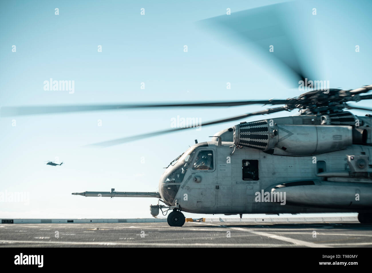 190511-M-HB658-0111 PACIFIC OCEAN (May 11, 2019) A U.S. Marine Corps CH-53E with Marine Medium Tiltrotor Squadron (VMM) 163 (Reinforced), 11th Marine Expeditionary Unit (MEU), sits on the flight deck of the San Antonio-class amphibious transport dock ship USS John P. Murtha (LPD 26). The Marines and Sailors of the 11th MEU are conducting routine operations as part of the Boxer Amphibious Ready Group. (U.S. Marine Corps photo by Staff Sgt. Donald Holbert) - Stock Image