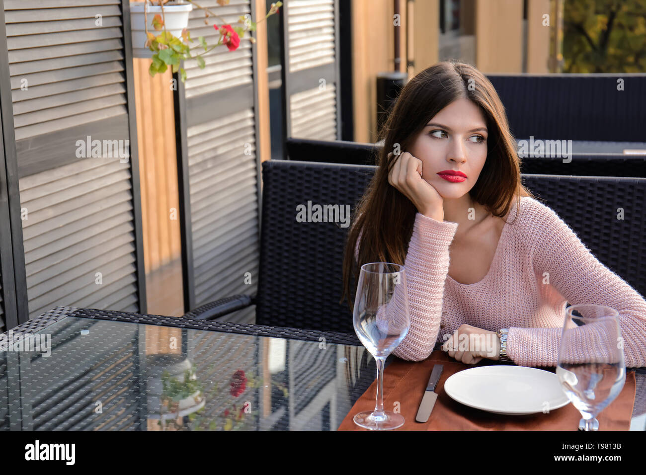 Young woman waiting for her boyfriend in cafe - Stock Image