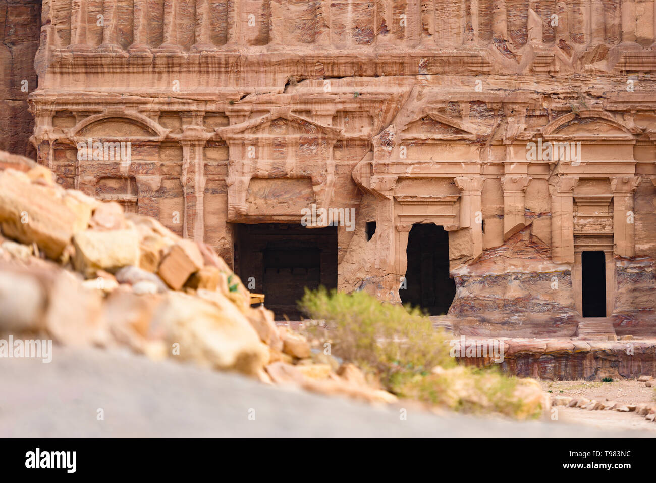 (Selective focus) Stunning view of a huge temple carved in stone in the beautiful Petra site. Stock Photo