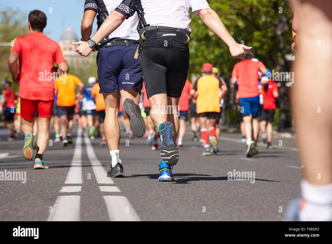 Marathon runners on the street. Healthy lifestyle. Athlete endurance - Stock Image