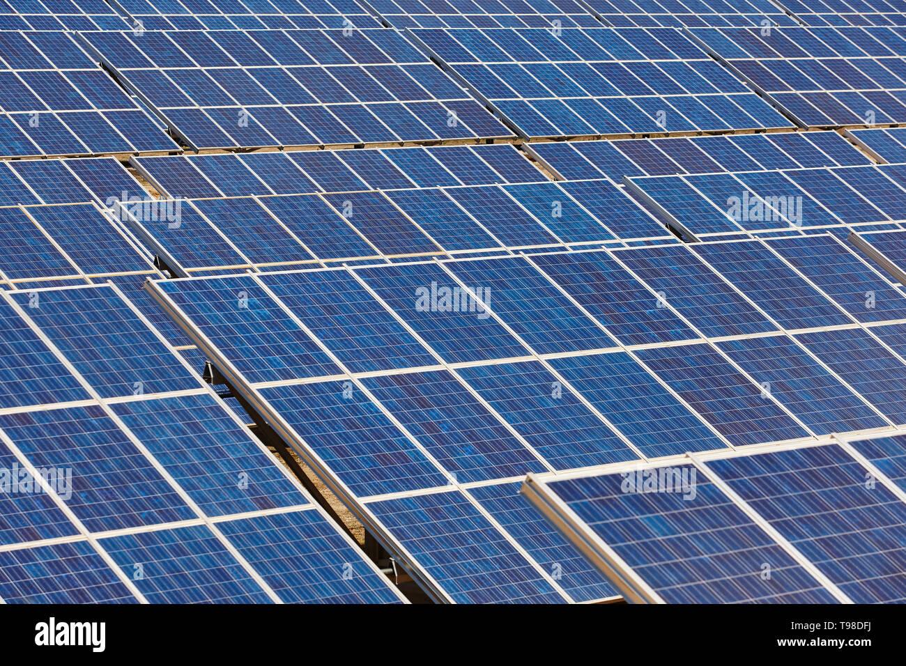 Solar panel plant. Sustainable renewable power energy and global warning - Stock Image